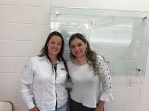 Paula da Festcolor com colega